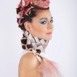 Karen Allen Model - Crazy braids with newspaper collar